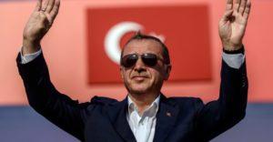 President Recep Tayyip Erdogan is greeting his audience.