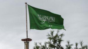 A Saudi flag is flying.